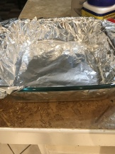 Line the glass dish with tin foil.